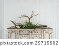 White ancient vintage commode with plants and 29719902