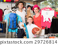 Smiling parents with boy shopping hiking goods 29726814