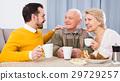 Smiling family having breakfast 29729257