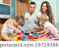Family of four at home with toys 29729366