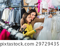 Mother and daughter choosing pretty dress 29729435