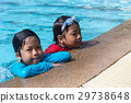 7 and 8 years old brother and sister swimming 29738648