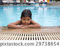 8 years old Asian kid swimming lonely  29738654