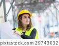 Young female engineer with office blueprints 29743032