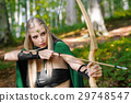 Beautiful female elf archer in the forest hunting 29748547