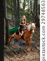Female elf in the forest with her horse  29748563