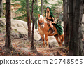 Female elf in the forest with her horse  29748565