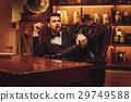 Confident upper class man smoking cigar in 29749588