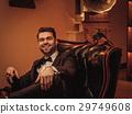 Confident upper class man smoking cigar in 29749608