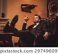 Confident upper class man smoking cigar in 29749609