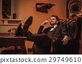 Confident upper class man smoking cigar in 29749610