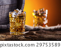 Two cups full of beverage whiskey brandy or cognac 29753589