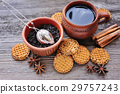 A cup of hot tea with cookies on wooden background 29757243