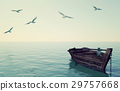 Wooden fishing boat floating over calm blue sea 29757668