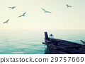 Wooden fishing boat floating over calm blue sea 29757669