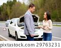 Couple near broken car on a highway roadside 29763231