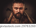 Viking with axes in a traditional warrior clothes 29763260