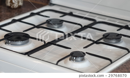 Clean and neat white gas stove 29768070
