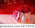 birthday concept with red roses in gift on wooden 29776448