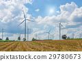 Many wind turbine in meadow. 29780673