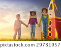 Children in astronauts costumes 29781957