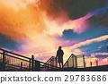 man standing on footbridge against colorful sky 29783686