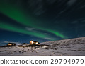 Aurora Borealis with cottage houses in winter 29794979