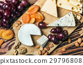 Assorted cheeses with grapes and nuts 29796808