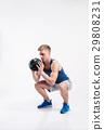 Handsome fitness man holding medicine ball, studio 29808231