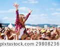 Teenagers at summer music festival enjoying 29808236