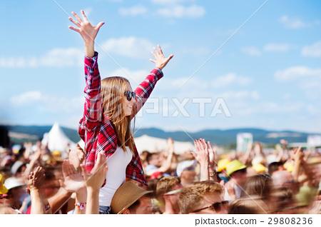 Teenagers at summer music festival enjoying 29808236