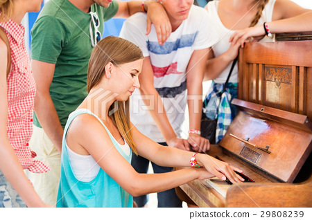 Teenagers at summer music festival, girl plays the 29808239