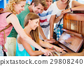 Teenagers at summer music festival, girl plays the 29808240