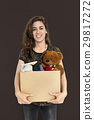 Woman Studio Portriat Casual Carrying a Box Isolated 29817272