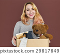 Woman Studio Portriat Casual Carrying a Box Isolated 29817849