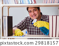Man cleaning dust from bookshelf 29818157
