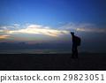 silhouettes on beach at sunrise 29823051