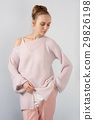 Pretty girl in angora sweater and slim pants 29826198