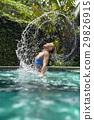 Girl does water hair flip 29826915