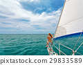 Happy girl on board of sailing yacht have a fun. 29833589