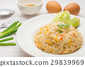 Fried rice with spicy sauce on white wooden table 29839969