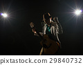 Asian Musician singing a song and playing the guitar which have a microphone on black background with spot light and lens flare, musical concept 29840732
