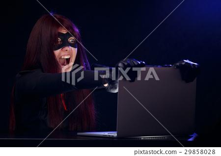 Thief at night near computer 29858028