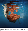 Girl in a red dress under the water 29859928