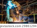 Robot welding metal part in factory 29861294