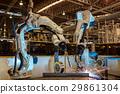 Team robots are test run welding in car factory 29861304