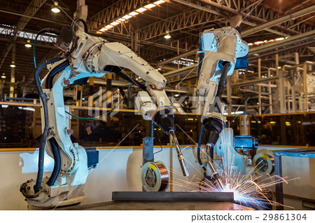 Team robots are test run welding in car factory 29861304