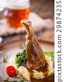 Confit lamb shank with mashed potatoes. 29874235