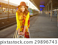 Pretty young woman at a train station (autumn toned image) 29896743
