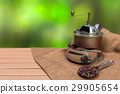 brown vintage coffee grinder with coffee beans 29905654